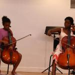 Cello duet at the O'Connor Method Camp NYC between Teacher Trainer Taiwo from Nigeria and camp student. Photo by Richard Casamento.