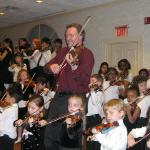 Mark O'Connor playing Method with children.